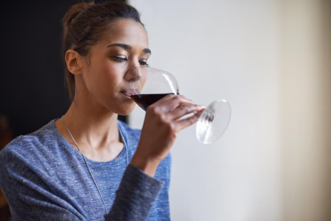 woman enjoying a glass of red wine